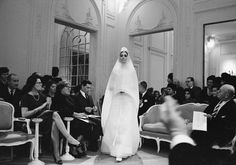 Kouka modeling Bohan's wedding dress in Dior's Grand Salon. In her opinion, ''the fashion house was temple-like,'' a world of good taste and general excellence.1961, Hyménée dress, Spring-Summer 1961 Haute Couture collection, Slim Look line.photo © Mark Shaw.