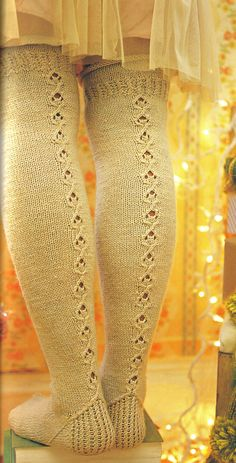 beautiful hand knit over the knee stockings..... pattern link here: http://www.ravelry.com/patterns/library/over-the-knee-socks