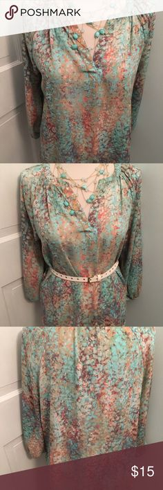 "Cynthia Rowley 100% polyester blouse.  3/4 sleeves Pastel print blouse by Cynthia Rowley.  Has 3/4"" sleeves with elasticized sleeve.  High low style.  Measures 22"" across bust line.  Pretty Alone or belted.  Pastel mint, coral colors.  So pretty Cynthia Rowley Tops Blouses"