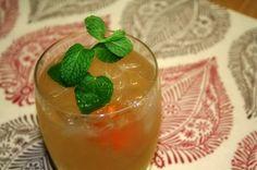 Honey Badger 4 oz. of Wild Turkey American Honey Bourbon (can substitute Seagrams 7 Honey) 4 oz. of ginger ale juice of half a lemon 1 in. piece of orange peel sprig of mint