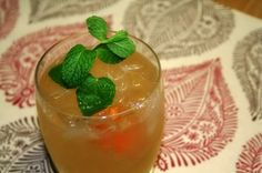 Honey Badger  4 oz. of Wild Turkey American Honey Bourbon (can substitute Seagrams 7 Honey)  4 oz. of ginger ale  juice of half a lemon  1 in. piece of orange peel  sprig of mint