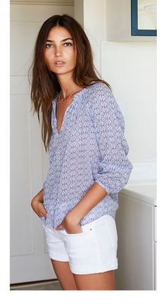 A light patterned blouse looks clean and polished with white shorts. Perfect for a summer bbq!