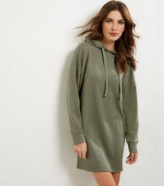 Bring comfort and style into your everyday wardrboe this season with this hooded jumper dress. Try complementing with a leather jacket and hooded boots to finish.- Hooded design- Simple long sleeves- Single pocket front- Cuffed hem- Casual fit that is true to size- Mini length- Dress length: 34