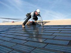 A roofer installs Dow Powerhouse Solar Shingles on a house. The technology combines a roofing shingle with a solar cell. When hooked up to an inverter, the shingles generate power to help offset the homeÕs energy costs. Roofing Companies, Roofing Services, Roofing Systems, Roofing Contractors, Roofing Specialists, Roofing Products, Construction Contractors, Leeds, Solar Energy
