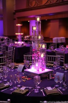 Stunning table centerpieces and linen on a purple wedding