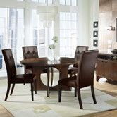 Love the round....maybe more unique chairs, but nice. Found it at Wayfair - Manhattan Dining Table