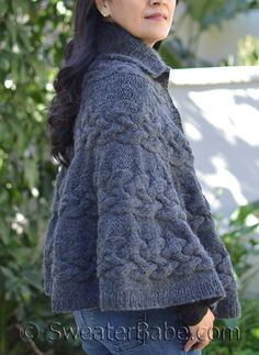 Chunky cables make for a bold poncho. This is a fun knit using short rows to create the tiered shape.