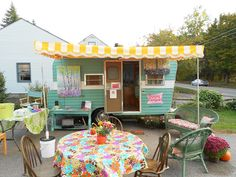 artist Kristina Wentzell sits in from of the Happy Camper Mobile Art Gallery        seating area inside the Happy Camper     inside the...