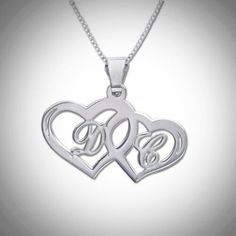 """Sterling Silver Hearts Pendant Material:Sterling Silver 0.925 Style:Two Hearts and Initials Thickness:0.7mm / 0.03"""" Height of pendant:8 - 12mm 0.3""""-0.5"""" Chain style:Silver Box Chain Chain length:14"""",16"""",18"""",20"""",22"""" Inscription Language:EnglishSterling silver (0.925) pendant comes with a Sterling silver (0.925) Box chain.  Please provide us with two letters when ordering this item. Letters are capitalized. """