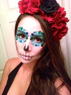 halloween makeup dia de los muertos day of the dead: I made the head band by hot glueing flowers to an old head band and I bought the gems from michaels and used eyelash glue as the adhesive.