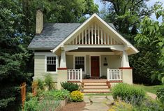 Bennett Frank McCarthy Architects- Bungalow Remodel. Love the roof and front yard garden.