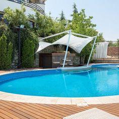 Badr Pool-Lavasan Photo by @mhettfagh  سایبان کنار استخر ساختمان بدر لواسان- بلوار صحرای نارون #dibats #tensilestructure #tensilefabric #سازه_های_پارچه_ای_دیبا #سایبان#iran