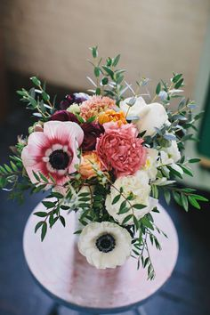 anemone floral arrangement, photo by Clean Plate Pictures http://ruffledblog.com/stylish-green-building-wedding #weddingflowers #flowers