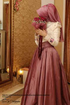 This unique wedding dress makes any bride look gorgeous on her big day and adds a pop of color!! This deep Rose colored dress is perfect for a early fall wedding. But dont make the mistake of having your bridesmaid wear the same color. Have them wear a color thats within the color palette and comoliments your dress. #wedding #Rose #color #dress #Hijab #hijabista #fashion #fall #unique