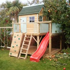 Lawn & Garden:Wonderful Brown Natural Wood Garden Playhouse Design Ideas For Kids With Red Modern Plastic Slide And Brown Natural Wood Stair Near Brown Wood Climb Added Green Seagrass Simple Garden Playhouse Inspiration for Your Kids