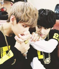 V kissing Junkook's hand? Your guess is as good as mine as to what's going on in this picture.