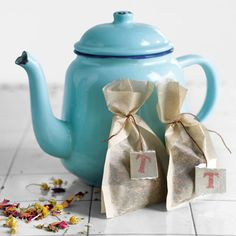 Calming Herbal Tea - Whipping up homemade tea involves nothing more than mixing dried herbs. Put the mixed herbs in petite sacks cinched with thread and labeled with hand-cut, hand-stamped tags. A gift anyone would appreciate :)