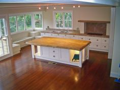 Love the window seating in this kitchen, and the HUGE island bench (Time 4 Timber, Aust.)