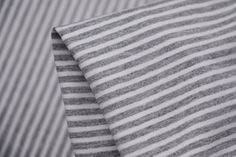 Grey Marle/White striped quality 92% Viscose 8% Elastane Jersey. Width: 150cm wide Ide...