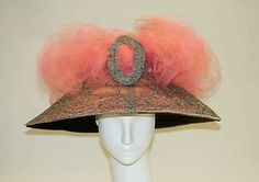 Hat    Date:      ca. 1910  Culture:      American  Medium:      silk  Dimensions:      Height: 6 3/4 in. (17.1 cm) Diameter: 18 in. (45.7 cm)