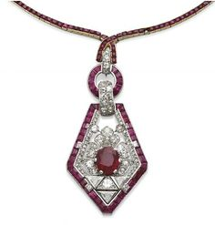 Ruby, diamond and platinum pendant by Cartier circa 1925 and a ruby, gold and platinum chain