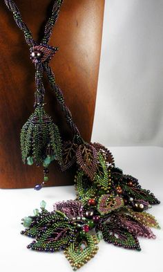 Reserved for Tammara: Beadweaving - Spiral Rope Necklace with Russian Leaves - Deep Green, Amethyst, Burgundy. $500.00, via Etsy.