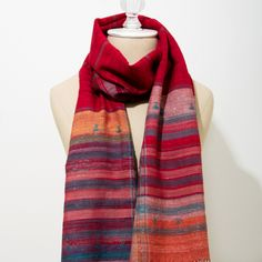 Mitha Scarf       Add a hint of refreshing color to your look with this jewel tone scarf handwoven of cotton and silk.