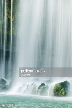 Waterfall falling on moss covered rocks