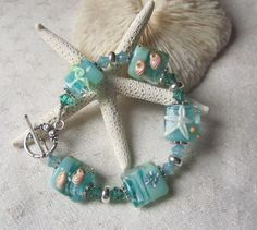 Down by the Seashore Bracelet - Very Beachy Beads in Ocean Colors of Teal and Pacific Opal. $65.00, via Etsy.