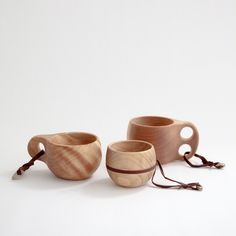 handcarved mugs from arctic birch- made for camping to tie onto your backpack but I just think they're really cool- Carley