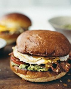Applewood-smoked bacon, sliced turkey, avocado, tomato, and blue cheese are stacked on a toasted brioche bun. Top the sandwich with an over-easy fried egg.