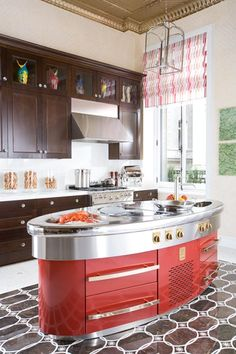 the sexy lipstick-red Molteni Cooking podium shouts that this kitchen is for passionate cooks