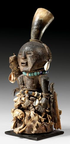 Africa | ma'nkishi power figure from the Songye people of Congo | Wood, leather, textiles, horn, cowrie shells, bones, glass beads and other materials