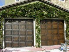 Metal garage doors w/ faux wood paint finish