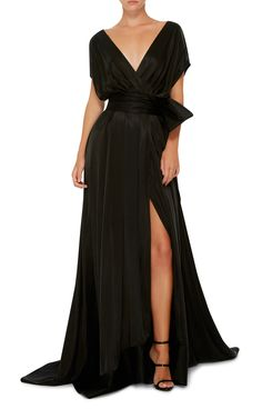 Hensely Black Satin Gown with Deep V-Neck and Draped Sleeves. The Waist is Wrapped with a Wide Sash that Ties on the Side in an Oversized Bow.  The Skirt has Wide, A-Line Silhouette with a Deep Slit and Sweep Train. Now, give this Classy Classic what it wants - Diamonds! I've got a 5-Strand Necklace, Drop Earrings, a Chunky Bracelet and 2 Rings. Finish with Black Ankle Tie Sandals & Satin Clutch (It's all on this board). Is that the Sweet Look of Confidence I see? It's well placed…