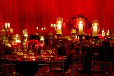The candelabra centerpieces were accented with bouquets of deep red roses. - not my colors but I love it
