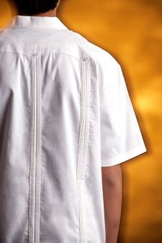 """http://theguayaberashirtstore.com  For kids ages four through twelve.  Our Kids J. Edwards """"Classic"""" embroidery shirt is made from 100% """"pinpoint cotton oxford"""".  This design is patterned after the traditional Guayabera as worn in Mexico and Latin America.  It features a beautiful embroidery pattern on the front of the shirt, no pockets and a vented hem."""