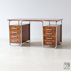 Tubular steel desk by Rudolf Vichr