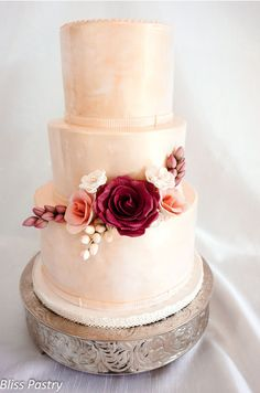 If the icing was white (not so pinkish), this might be my favorite.  Champagne Pink Wedding Cake