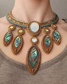 """Treasure of Atlantis"", features moonstone, swarovski crystals and paua shell, by Natasha Shcherbakova,"