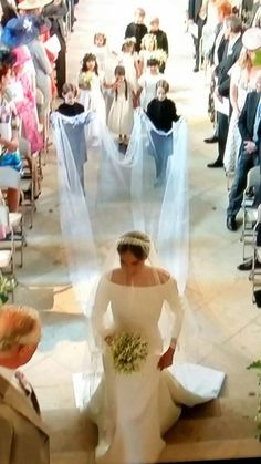 Beautiful capture of the wedding processional of Duchess Meghan. Love the children following behind.