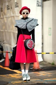 30 Inspired Looks From Tokyo Fashion Week #refinery29 http://www.refinery29.com/2014/10/76579/tokyo-street-style-pictures-2014#slide21 We could just tie this look up in a bow and take it home with us.