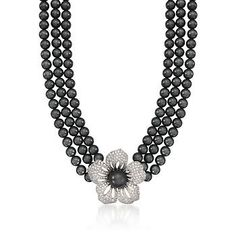 Our glamorous showcase of iridescent black mother-of-pearl beads is showcased by a blossoming flower and center pearl. >>Click on the Flower Necklace to see more options at Ross-Simons.