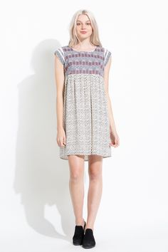 The intricate embroidery on this bohemian THML dress is the perfect detail!