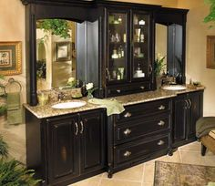 Fieldstone Cabinetry Augustine door style in Maple finished in Amaretto.