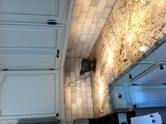 White Delicatus granite with honed Carrara subway tile