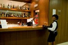 Guests are invited to relax and enjoy the bustling city of Luanda in Angola from the comfort of the four-star Skyna Hotel Luanda. Liquor Cabinet, Hotels, African, Home Decor, Decoration Home, Room Decor, Home Interior Design, Home Decoration, Interior Design