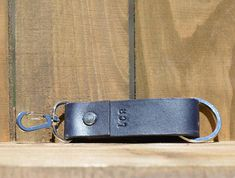 Personalized Monogrammed Leather Key Chain with Multiple Tool, Custom Made Key Chains as Gifts  This leather key fob is not only to help keep track of your keys but also can add a multiple functional tool. The hook allows you to attach it securely to your belt, loops, straps, and more. The sturdy split rings allows you to put your keys. The tool is optional.  I personally handmade each key chain, so every leather piece is one of a kind.  Features: Premium vegetable tanned leather piece dyed…