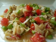 saltfish buljol.      1/4 lb dried saltfish   1/2 medium onion sliced very thin   1 medium tomato cubed   1 clove garlic chopped very small   1/4 cup green bell pepper cubed   1 green onion (scallion) chopped thin   dash of black pepper   4 tablespoons extra virgin olive oil