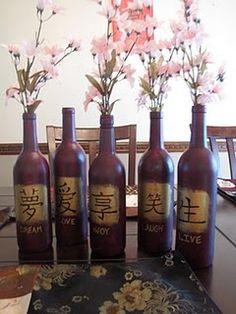 Painted wine bottles as vases.